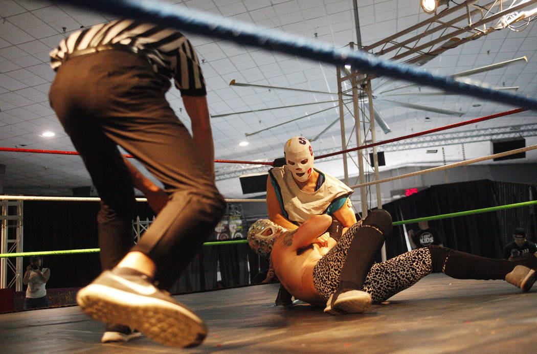 Mati Matico Tres holds down Loco B. Ware during a match at a Lucha Libre show at the Sahara Event Center in Las Vegas, Sunday, April 8, 2018. Rachel Aston Las Vegas Review-Journal @rookie__rae