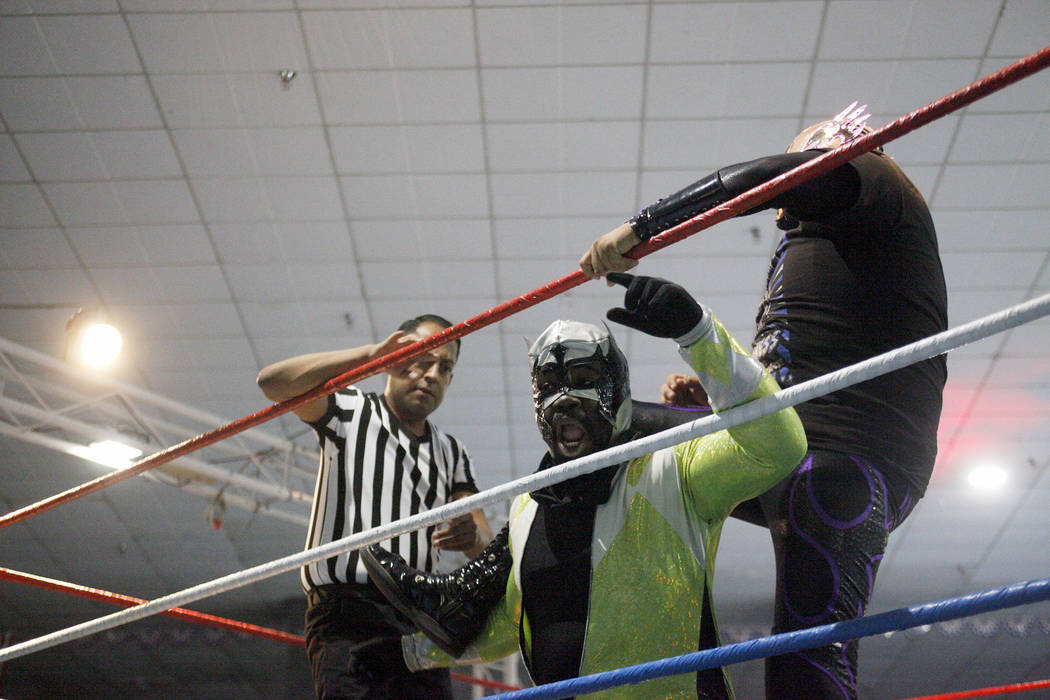 Madness holds down Claustrophobia during a match at a Lucha Libre show at the Sahara Event Center in Las Vegas, Sunday, April 8, 2018. Rachel Aston Las Vegas Review-Journal @rookie__rae