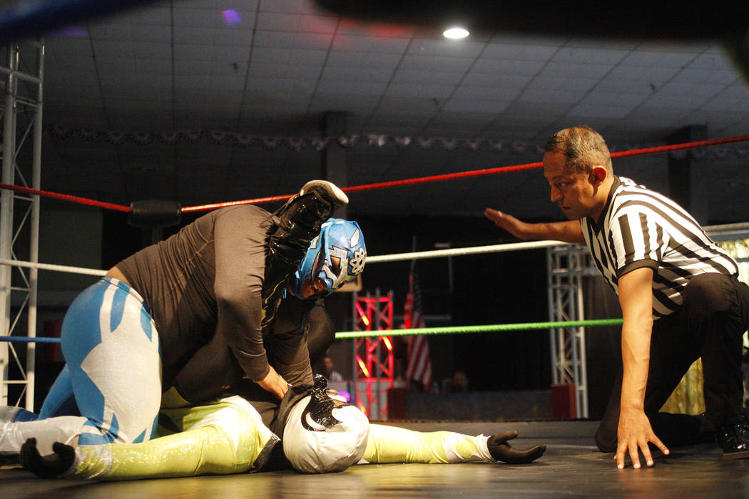 Atomico holds down Claustrophobia during a match at a Lucha Libre show at the Sahara Event Center in Las Vegas, Sunday, April 8, 2018. Rachel Aston Las Vegas Review-Journal @rookie__rae