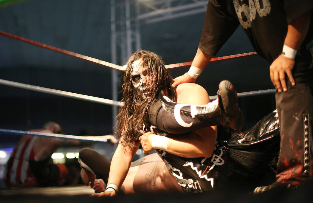 Bestia 666 holds down Funnybone as his teammate Damian 666 watches during a match at a Lucha Libre show at the Sahara Event Center in Las Vegas, Sunday, April 8, 2018. Rachel Aston Las Vegas Revie ...