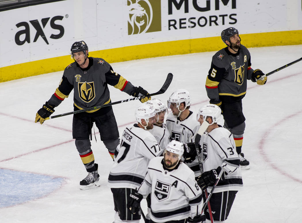 Los Angeles Kings players celebrate after Los Angeles Kings center Jeff Carter (77) scored their fourth goal of the game while Vegas Golden Knights defenseman Brayden McNabb (3) and Vegas Golden K ...