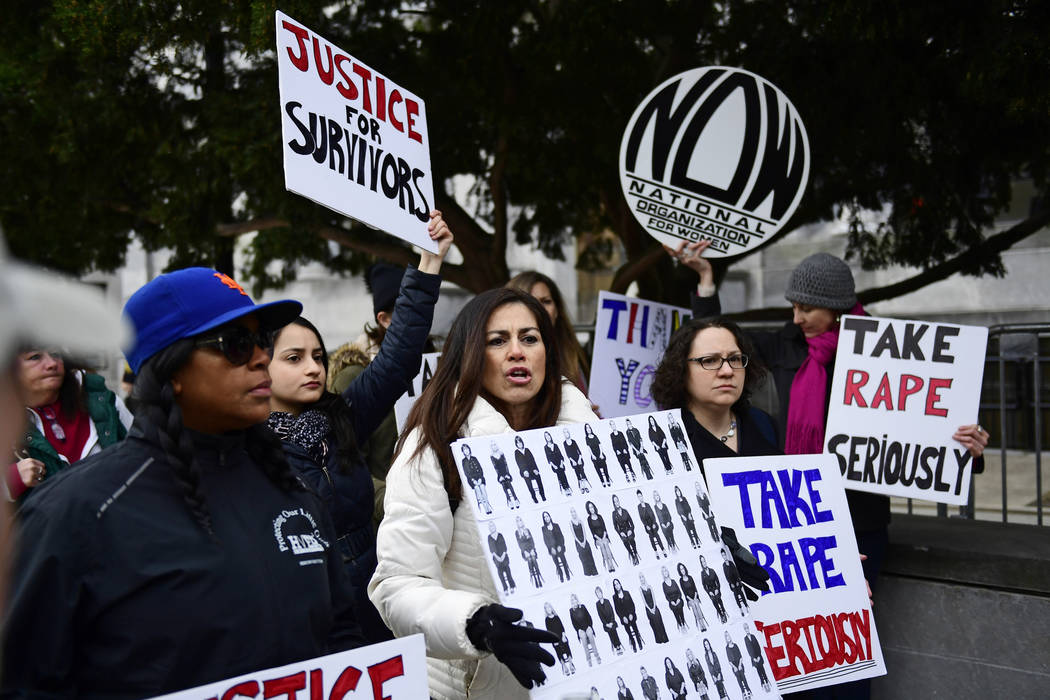 Sonia Ossorio, center, president of the National Organization for Women of New York, leads a group in protest, after Bill Cosby arrives for his sexual assault trial at the Montgomery County Courth ...