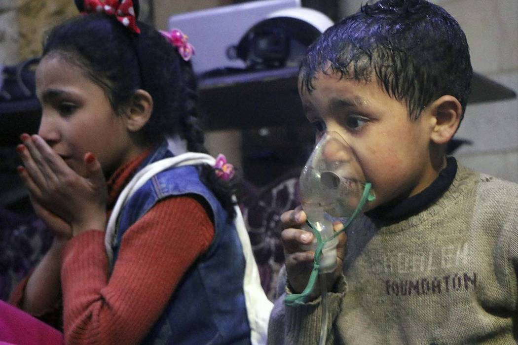 This image released early Sunday, April 8, 2018 by the Syrian Civil Defense White Helmets, shows a child receiving oxygen through respirators following an alleged poison gas attack in the rebel-he ...