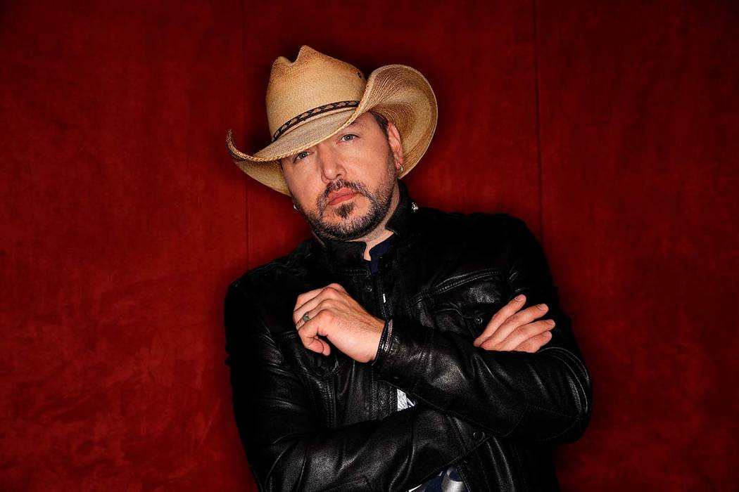 """In this March 19, 2018, photo, country music singer Jason Aldean poses in Nashville to promote his eighth studio album """"Rearview Town."""" The album will be released on Friday. (Mark Humphrey/AP)"""