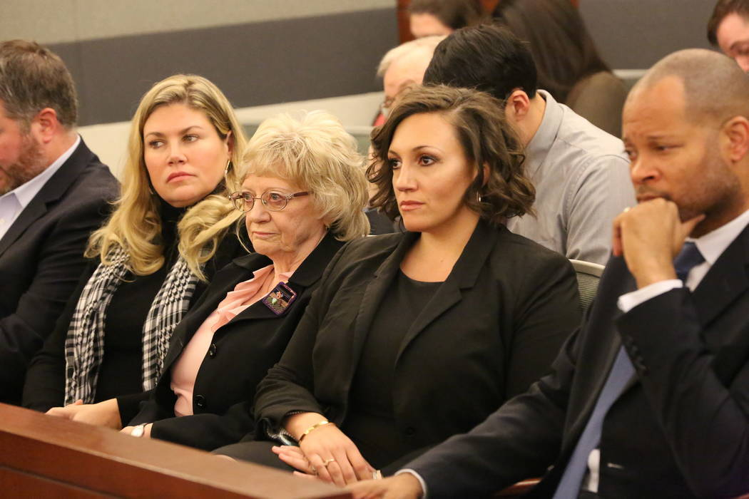 Recall opponents Joyce Woodhouse, center, and Nicole Cannizzaro, right, listen as attorney Marc Elias argues whether it is constitutional to allow people to have their names removed from a recall  ...