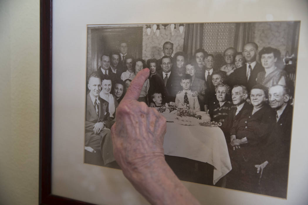 Maryann Lawrence points to herself in a family picture at her Las Vegas home, Tuesday, April 10, 2018. Maryann and her relatives helped her cousin Mary Szymerski immigrate to the United State ...