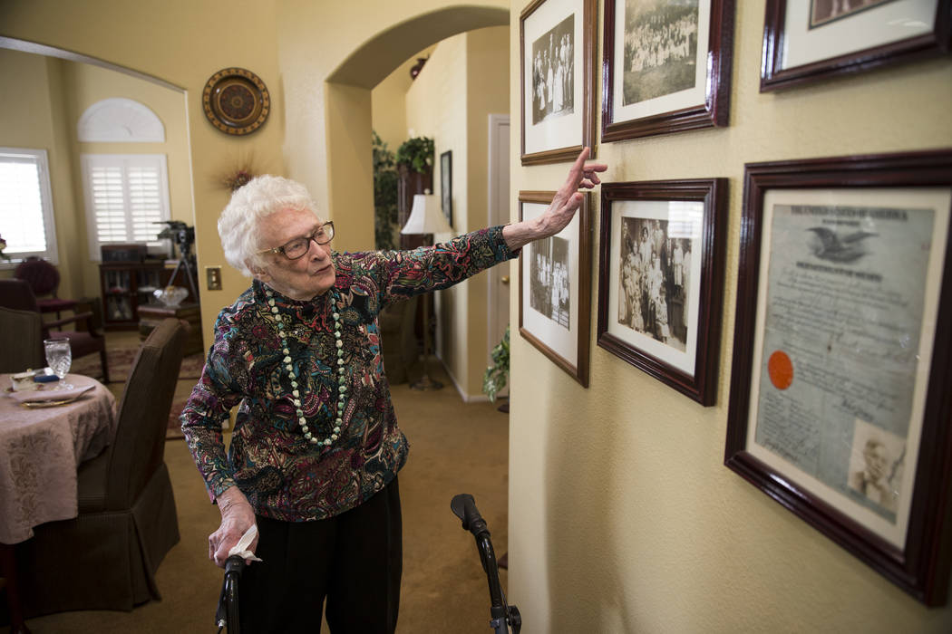Maryann Lawrence shows family pictures at her Las Vegas home, Tuesday, April 10, 2018. Maryann and her relatives helped her cousin Mary Szymerski immigrate to the United States after spending ...