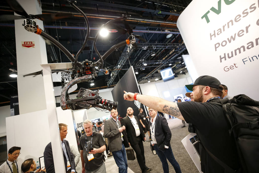 A show attendee browses over Shotover's U1, a professional-grade unmanned aerial vehicle for broadcast, motion picture, surveillance and industrial survey markets, during the NAB Show at the Las V ...