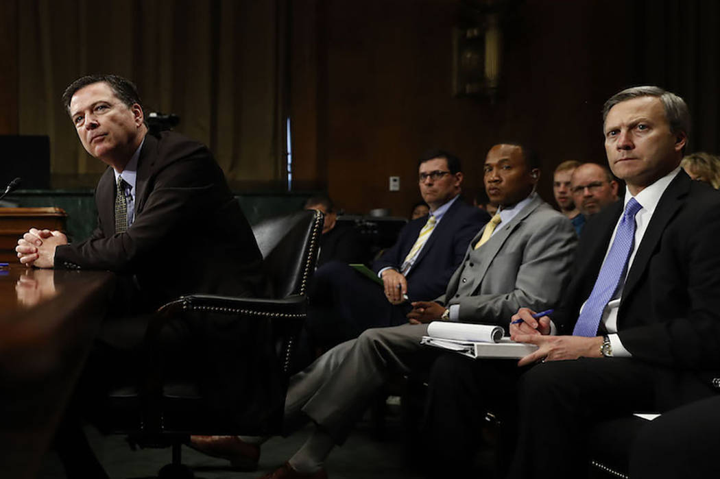 FBI Director James Comey pauses as he testifies on Capitol Hill in Washington, Wednesday, May 3, 2017, before the Senate Judiciary Committee hearing. Behind him, right, is Assistant FBI Director G ...