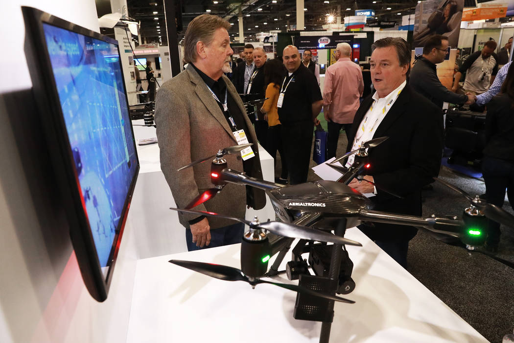 Gregory Erickson, of Indiana, right, talks to Terry Spencer, director of sales, about the Aerialtronics Altura Zenith during the International Security Conference & Exposition, also known as I ...