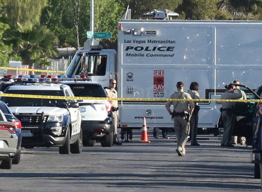 Las Vegas police investigate an officer-involved shooting at Madge Lane and Mabel Road, between Charleston Boulevard and Stewart Avenue, Friday, April 6, 2018, in Las Vegas. Bizuayehu Tesfaye/Las  ...