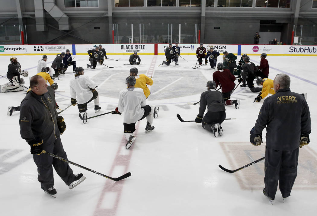 The Vegas Golden Knights head coach Gerald Gallant, left, and assistant coach Mike Kelly, watch as their players stretch during team practice on Monday, April 9, 2018, in Las Vegas. Bizuayehu Tesf ...
