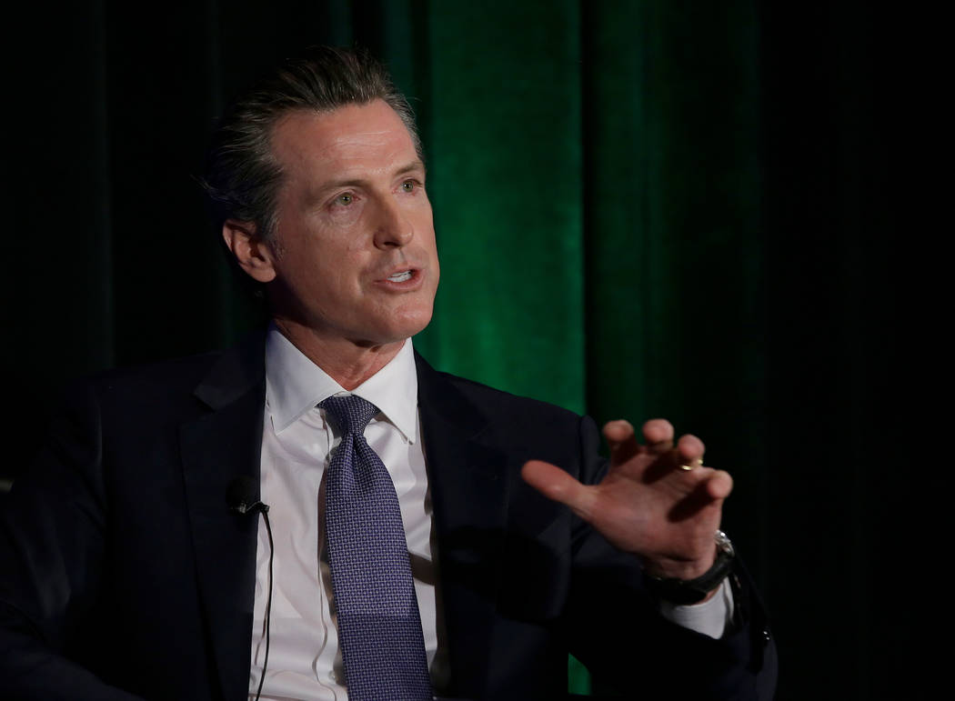In this March 8, 2018, file photo, California gubernatorial candidate Lt. Gov. Gavin Newsom, a Democrat, discusses the state's housing problems at a conference in Sacramento, Calif. (AP Photo/Ric ...
