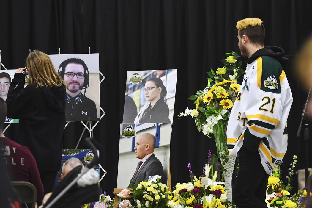 Humboldt Broncos' Nick Shumlanski, who was released from hospital earlier today, looks at photographs of other victims during a vigil at the Elgar Petersen Arena, home of the Humboldt Broncos, to  ...