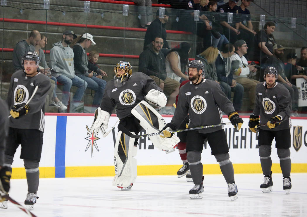 Vegas Golden Knights players including goalie Marc-Andre Fleury, second left, skate during team practice at City National Arena on Monday, April 9, 2018, in Las Vegas. Bizuayehu Tesfaye/Las Vegas  ...