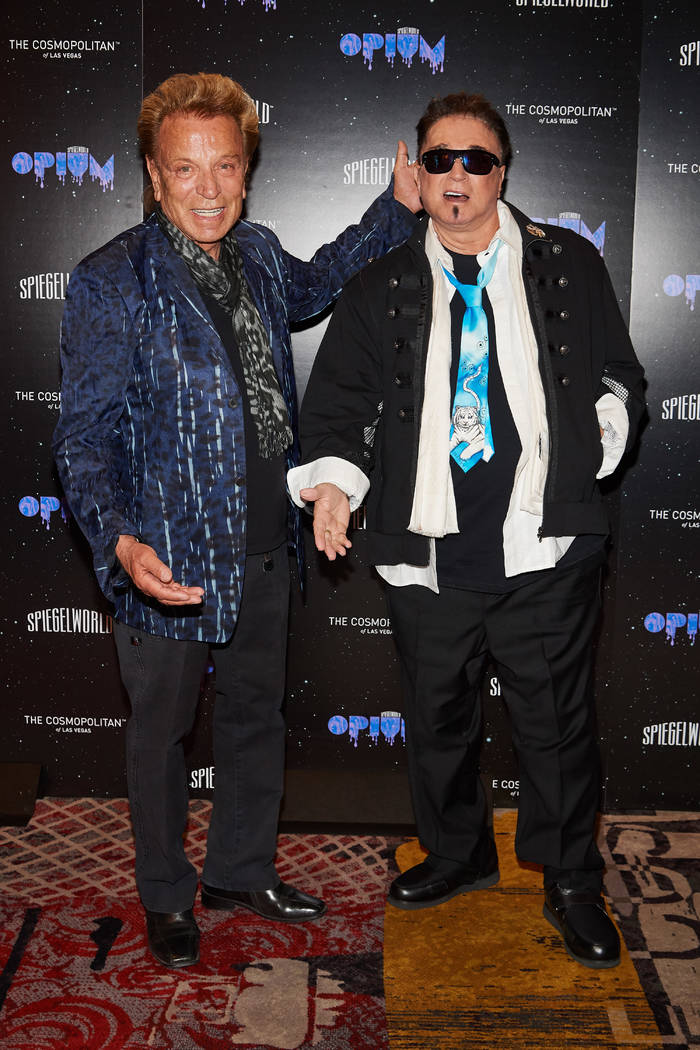 "Siegfried and Roy are shown at the red-carpet opening of ""Opium"" at the Cosmopolitan of Las Vegas on Sunday, April 10, 2018. (Al Powers)"
