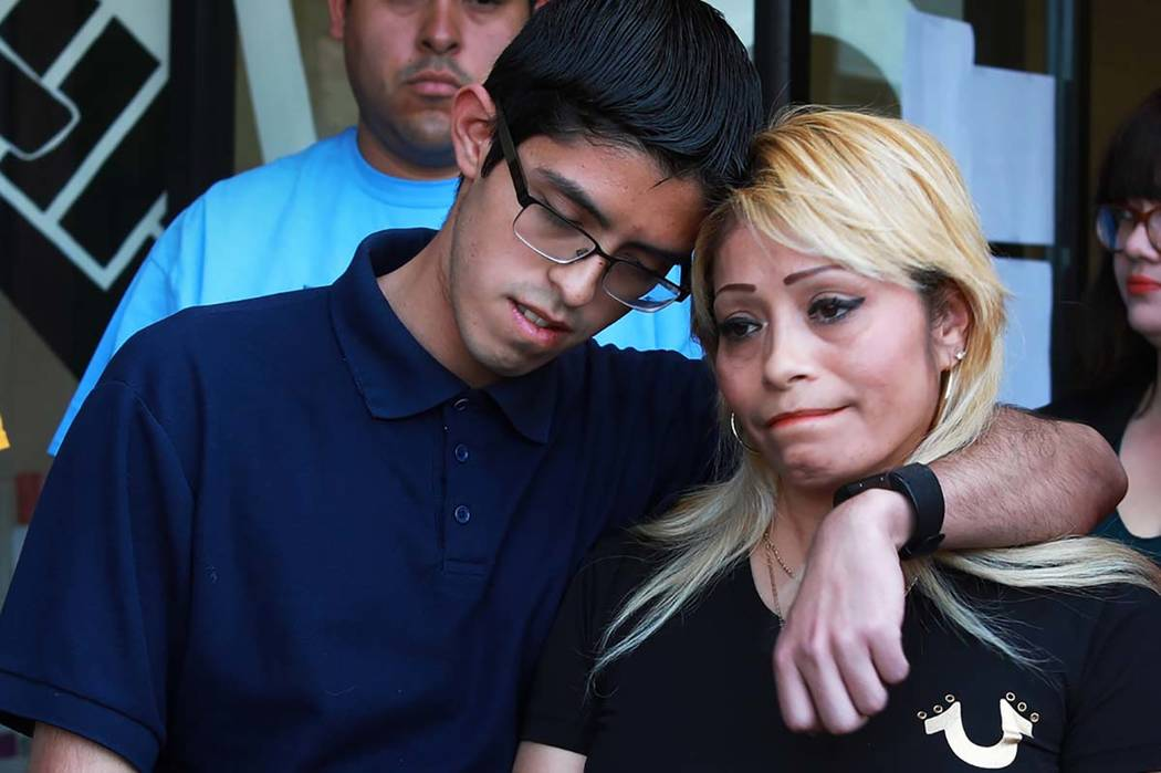 Cecilia Gomez, who was detained by Immigration and Customs Enforcement, is embraced by her son Ricardo Avelar-Gomez, 18, after describing her experience with ICE during a news conference at The La ...