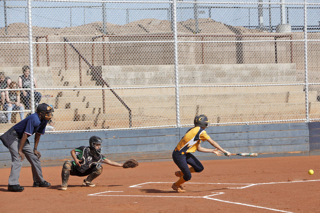 Marleena Mills prepares to dash for first after hitting the ball at a softball game against Virgin Valley in Boulder City, Monday, April 9, 2018. Rachel Aston Las Vegas Review-Journal @rookie__rae