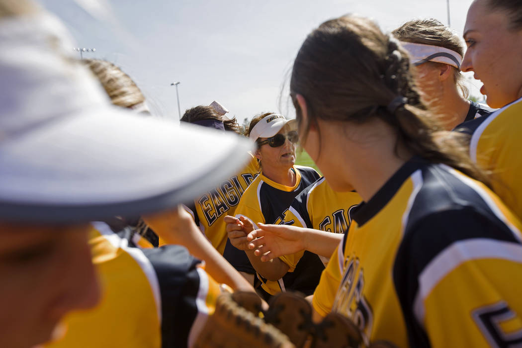 Boulder City High School softball coach Angelica Moorhead preps her team before the start of the game against Virgin Valley High School in Boulder City, Monday, April 9, 2018. Rachel Aston Las Veg ...