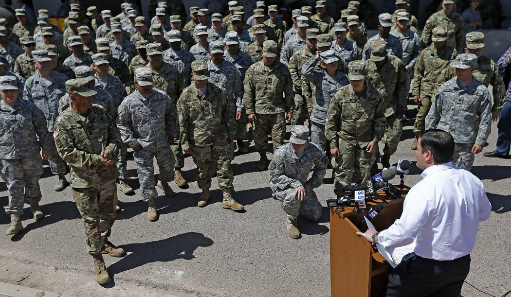 Arizona Gov. Doug Ducey speaks to Arizona National Guard soldiers prior to deployment to the Mexico border at the Papago Park Military Reservation Monday, April 9, 2018, in Phoenix. (AP Photo/Ross ...