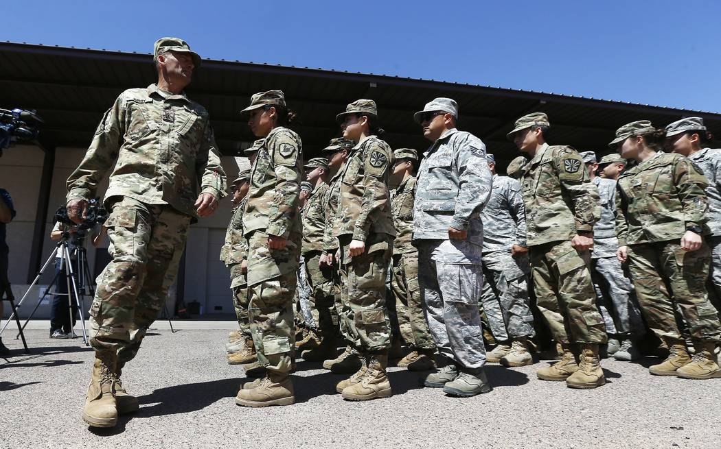 Arizona National Guard soldiers line up as they get ready for a visit from Arizona Gov. Doug Ducey prior their deployment to the Mexico border at the Papago Park Military Reservation Monday, April ...