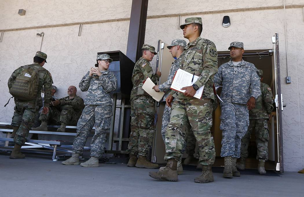 Arizona National Guard soldiers receive their reporting paperwork prior to deployment to the Mexico border at the Papago Park Military Reservation Monday, April 9, 2018, in Phoenix. (AP Photo/Ross ...