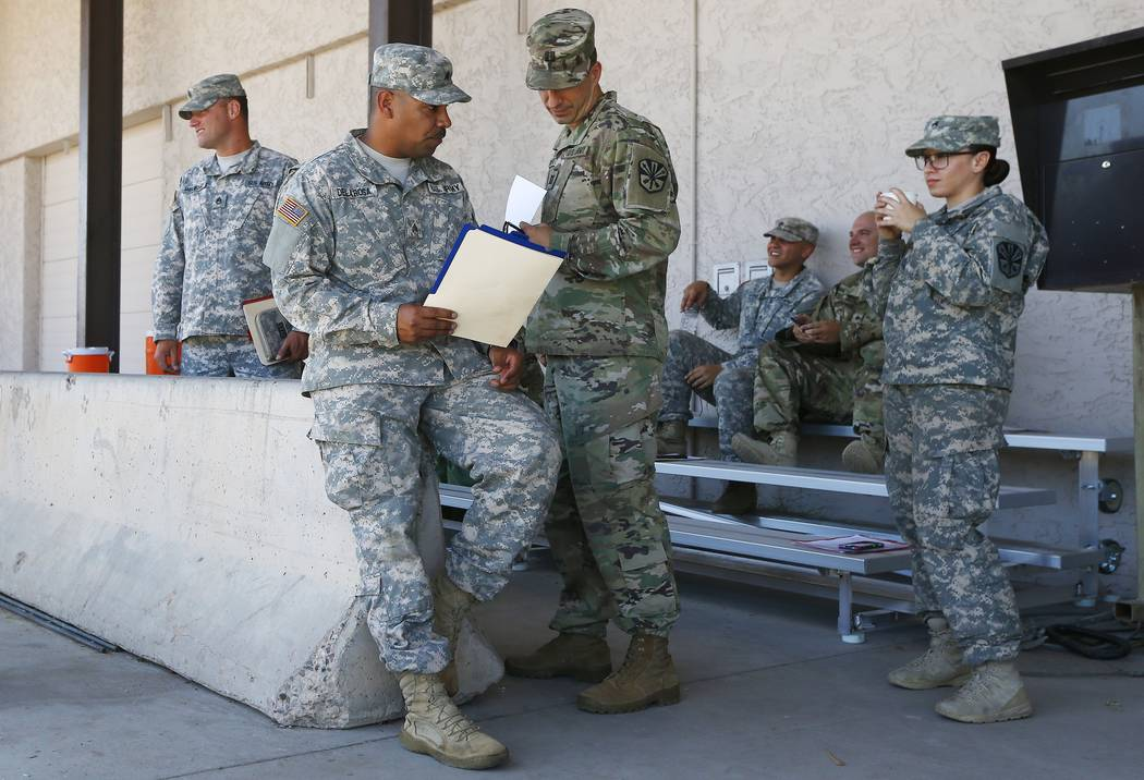 Arizona National Guard soldiers receive their reporting paperwork prior to deployment to the Mexico border at the Papago Park Military Reservation, Monday, April 9, 2018, in Phoenix. (AP Photo/Ros ...