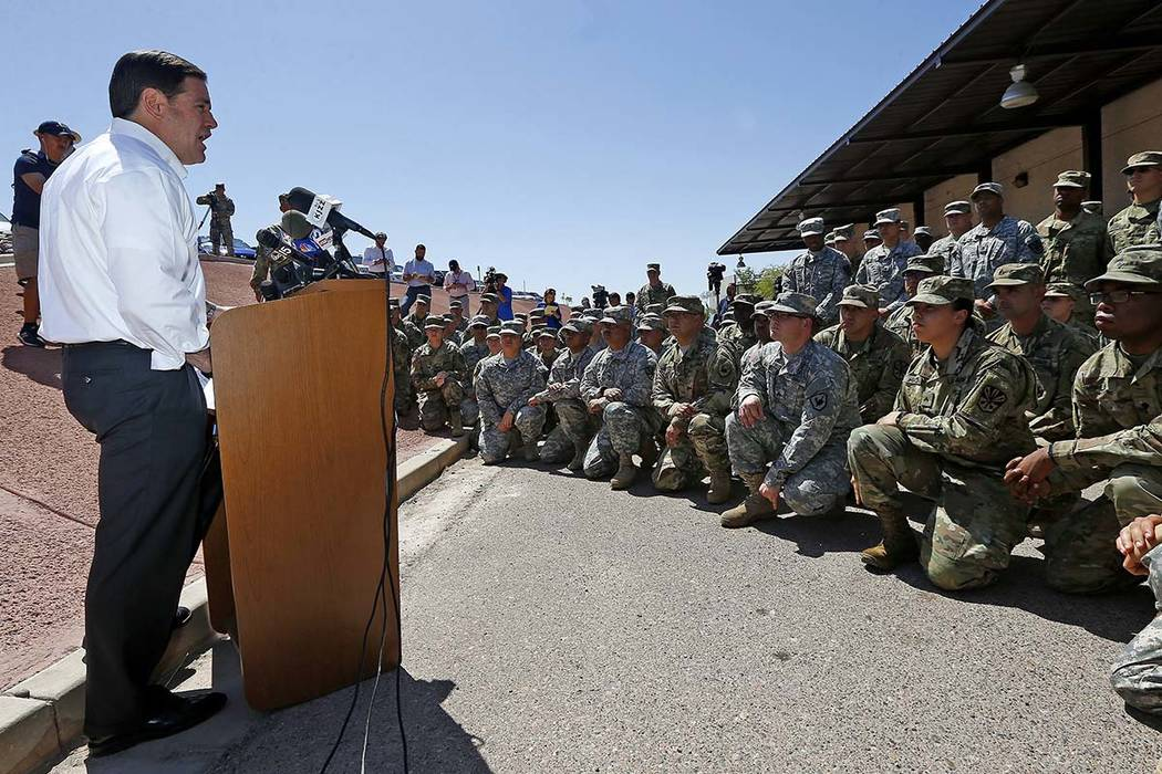 Arizona Republican Gov. Doug Ducey speaks to Arizona National Guard soldiers prior to their deployment to the Mexico border at the Papago Park Military Reservation, Monday, April 9, 2018, in Phoen ...