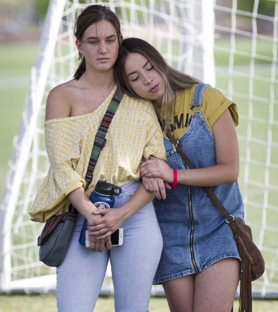 Ashlee Hawley, right, sister of Brooke Hawley, a Centennial High School student killed in a car crash with a drunk driver in California, hugs friend Alana Maurer during a press conference announci ...