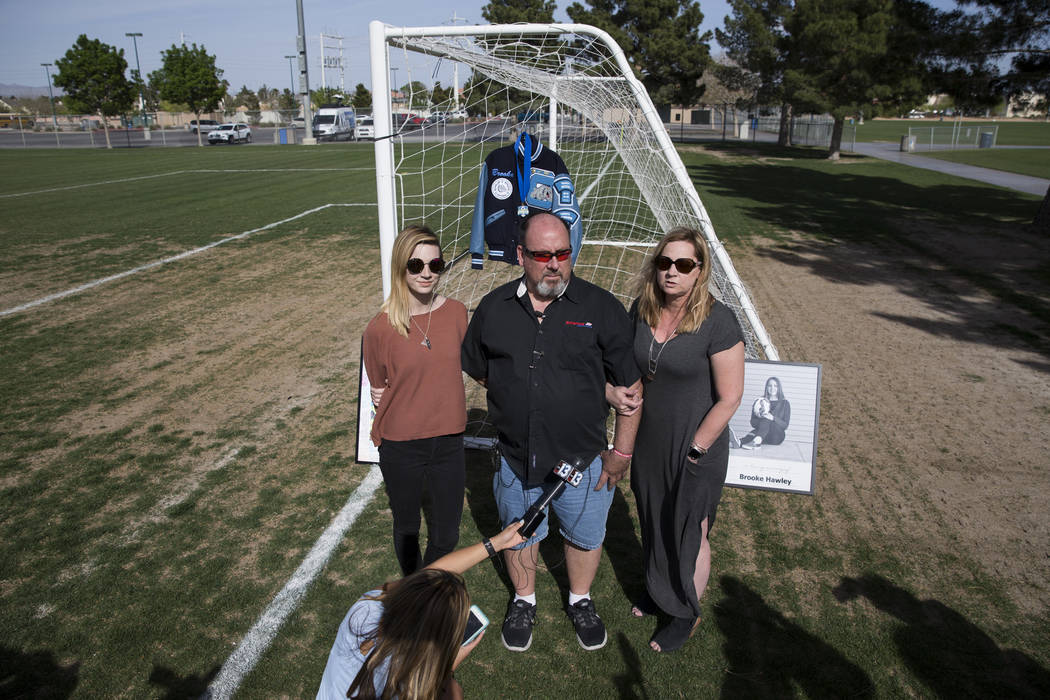 Heather Hawley, left, father Aaron and mother Rhonda speak during a press conference announcing the Brooke Hawley Memorial Scholarship, at the Bettye Wilson Soccer Complex in Las Vegas, Tuesday, A ...
