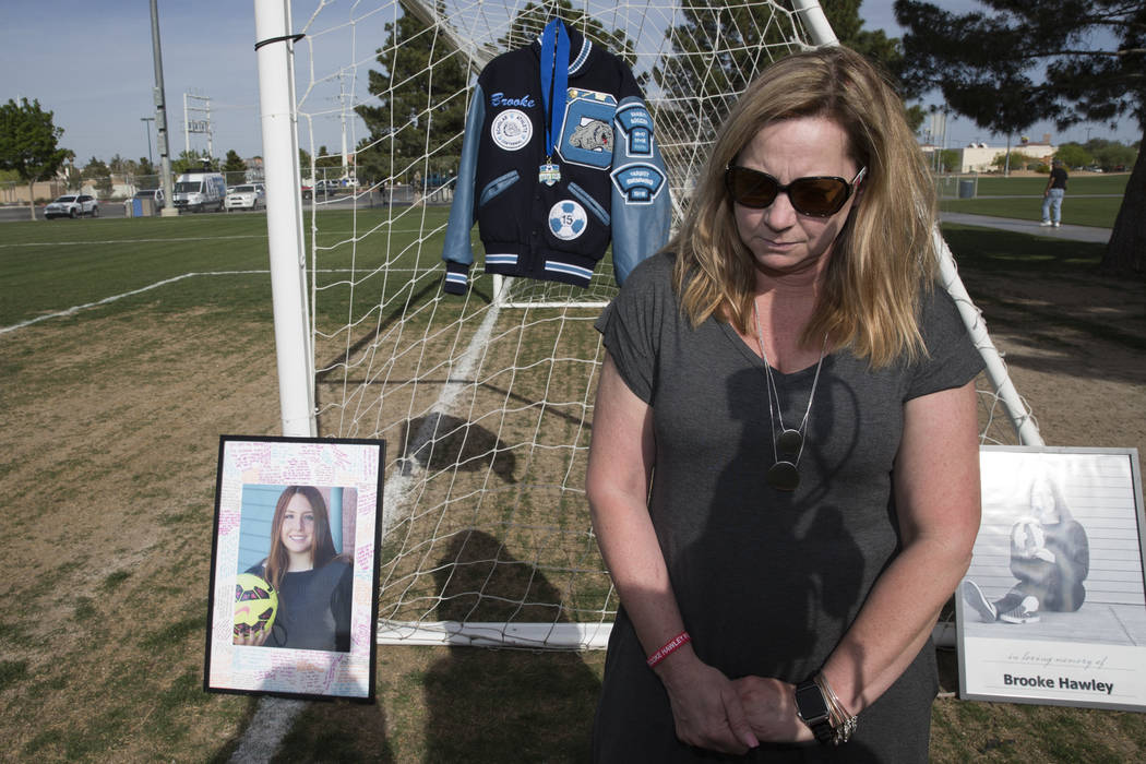 Rhonda Hawley pauses during an interview following a press conference announcing the Brooke Hawley Memorial Scholarship, at the Bettye Wilson Soccer Complex in Las Vegas, Tuesday, April 10, 2018.  ...