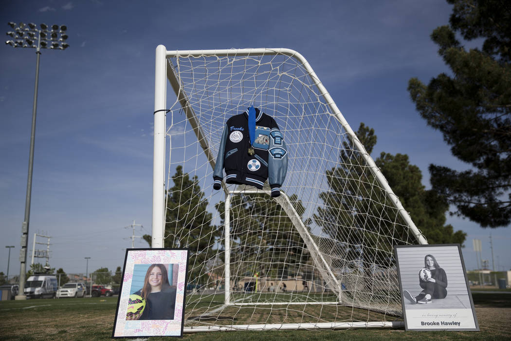 The letterman jacket and pictures of Brooke Hawley are displayed during a press conference announcing a memorial scholarship named after her at the Bettye Wilson Soccer Complex in Las Vegas, Tuesd ...