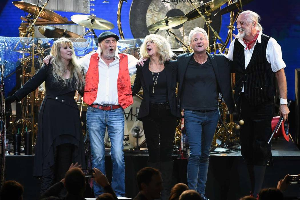 In this Jan. 26, 2018 file photo, Fleetwood Mac band members, from left, Stevie Nicks, John McVie, Christine McVie, Lindsey Buckingham and Mick Fleetwood appear at the 2018 MusiCares Person of the ...