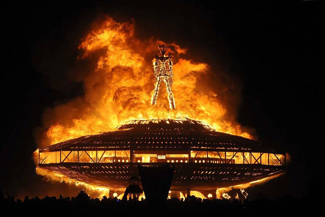 "The ""Man"" burns on the Black Rock Desert at Burning Man near Gerlach, Nev. on Aug. 31, 2013. (Andy Barron/The Reno Gazette-Journal via AP)"