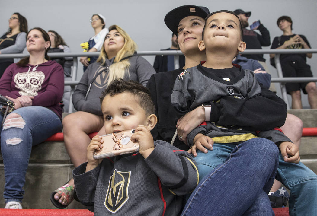 """Sarah Brown, middle, holds sons Zeke, right, and Zion during Golden Knights practice on Tuesday, April 10, 2018, at City National Arena, in Las Vegas. """"They're obsessed with goalies,"""" sa ..."""