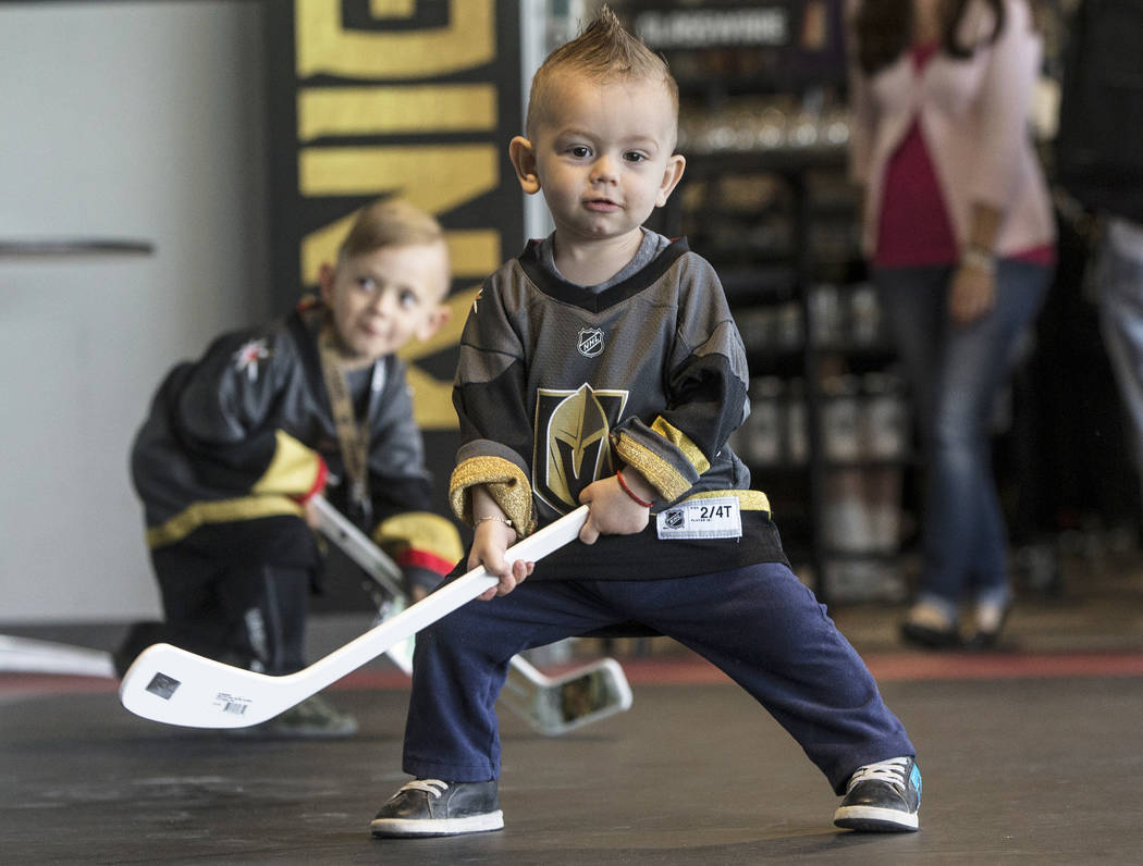 Nathan Jansson, front/middle, and brother Ayden play outside of Golden Knights practice on Tuesday, April 10, 2018, at City National Arena, in Las Vegas. Benjamin Hager Las Vegas Review-Journal @b ...
