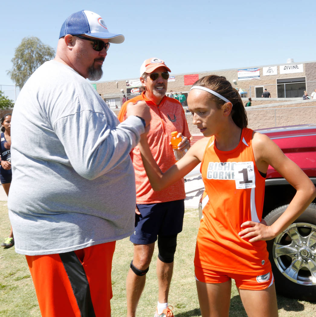 Bishop Gorman freshman Emilia Puskas (1) high fives Head Coach Scott Cooley after winning in the girls' 1600m during Blaine Thompson-Las Vegas Track Classic at Desert Oasis High School in Las Vega ...