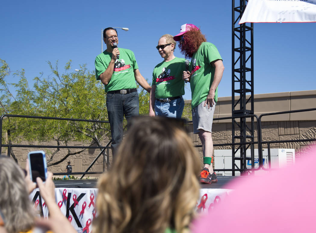 Penn Jillette, from left, Teller, and Carrot Top appear on stage during opening ceremonies for the 26th annual Aid for AIDS of Nevada (AFAN) AIDS Walk Las Vegas at Town Square in Las Vegas on Sund ...