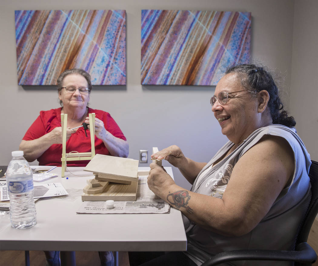 Army veteran Debbie Lara, right, builds shoe shine boxes with Carol Ambrose on Tuesday, April 17, 2018, at Patriot Place Apartments, in Las Vegas. Patriot Place Apartments is an affordable housing ...