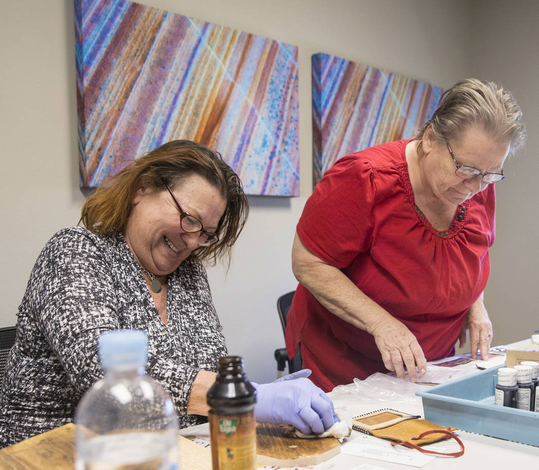 Clyda Byrd-Lopez, left, and Carol Ambrose build shoe shine boxes on Tuesday, April 17, 2018, at Patriot Place Apartments, in Las Vegas. Patriot Place Apartments is an affordable housing facility t ...
