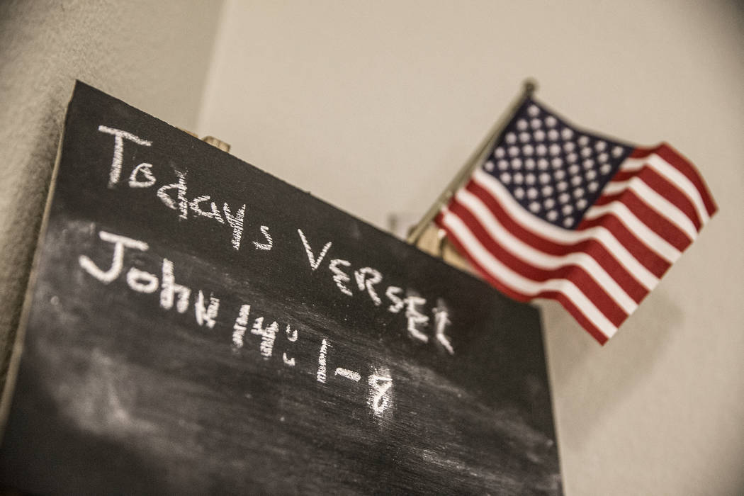 A chalk board referencing the bible verses John 14:1-8 outside a unit at Patriot Place Apartments on Tuesday, April 17, 2018, in Las Vegas. Patriot Place Apartments is an affordable housing facili ...