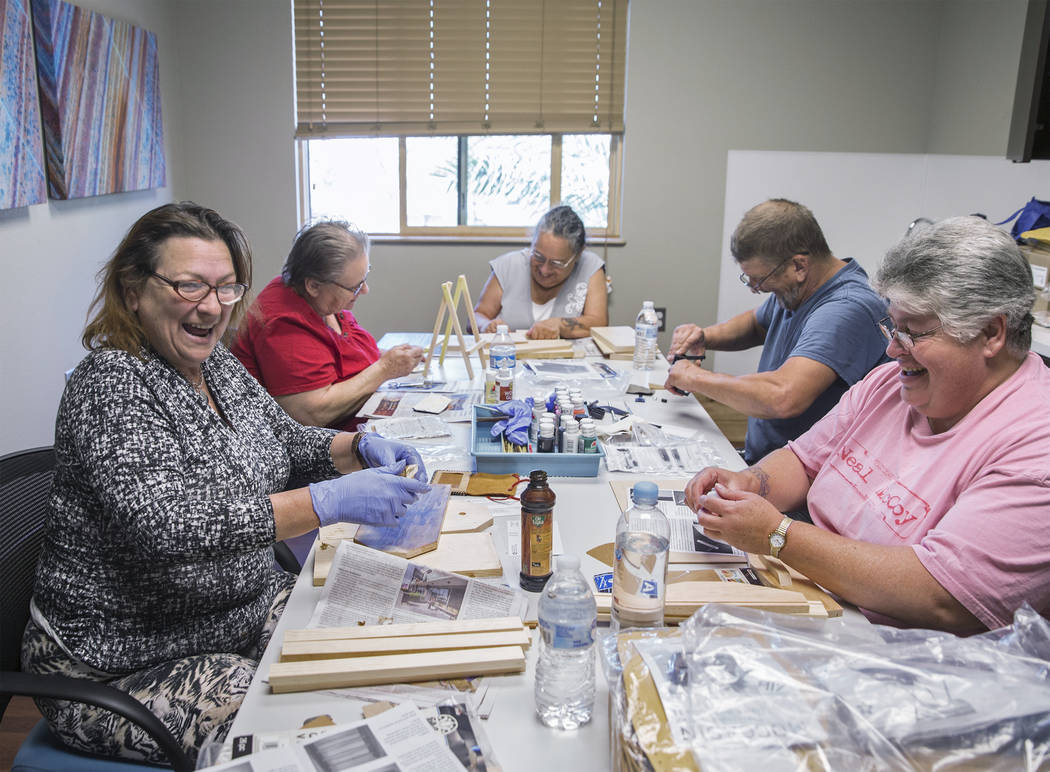 Clyda Byrd-Lopez, left, Carol Ambrose, Debbie Lara, William Bryant and Michele Marshall socialize while crafting on Tuesday, April 17, 2018, at Patriot Place Apartments, in Las Vegas. Patriot Plac ...