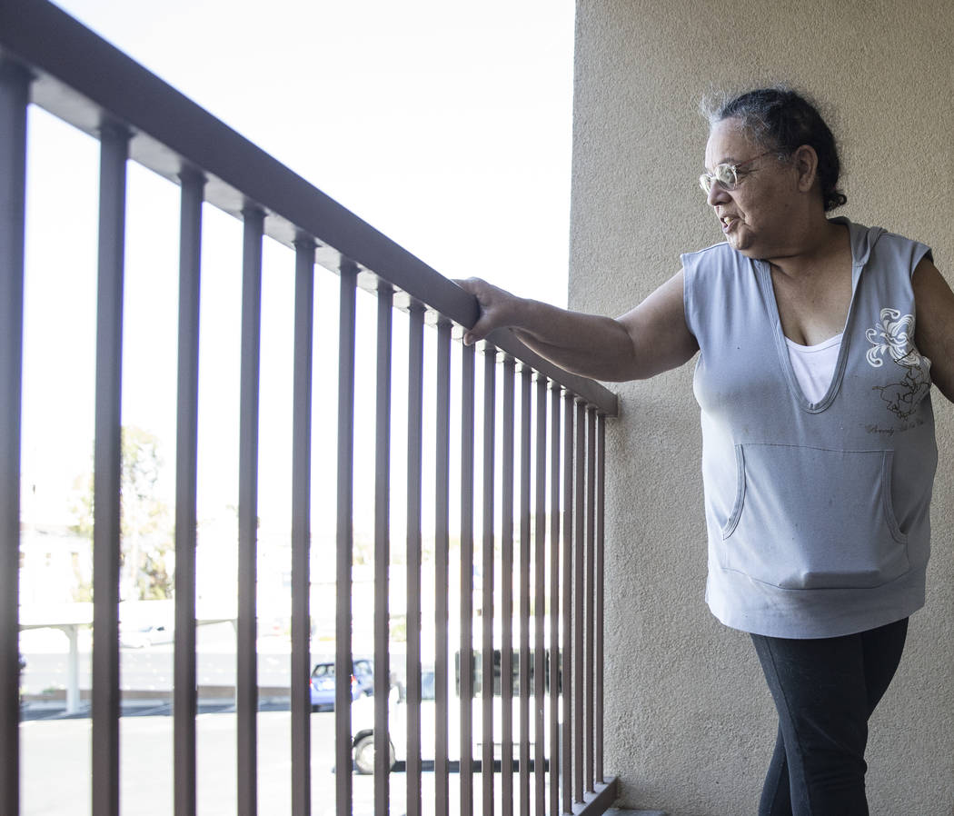 Army veteran Debbie Lara looks out into the courtyard from the porch of her new one bedroom, furnished apartment on Tuesday, April 17, 2018, at Patriot Place Apartments, in Las Vegas. Patriot Plac ...