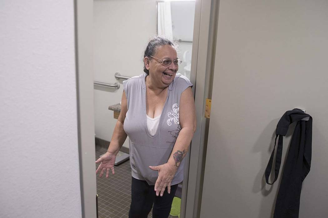 Army veteran Debbie Lara expresses her happiness with the size of her new bathroom in her one bedroom, furnished apartment on Tuesday, April 17, 2018, at Patriot Place Apartments, in Las Vegas. Pa ...
