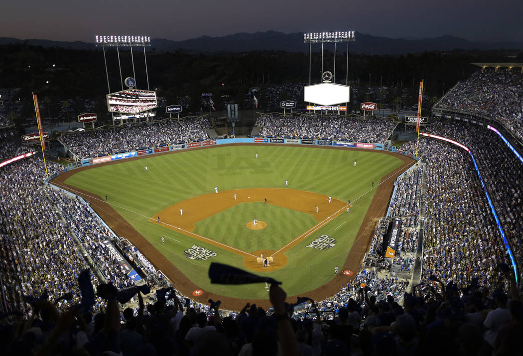 Dodgers Stadium is seen during the fourth inning of Game 2 of baseball's World Series between the Houston Astros and the Los Angeles Dodgers Wednesday, Oct. 25, 2017, in Los Angeles. (AP Photo/Tim ...