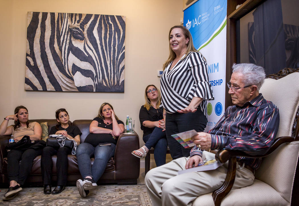 Ben Lesser, an 89-year-old Holocaust survivor, is introduced by Noa Peri-Jensch, the Las Vegas regional director of the Israeli American Council, at a Yom HaShoah, or Holocaust Rememberence Day, e ...