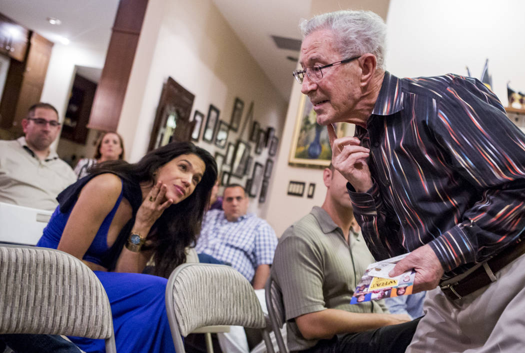 Ben Lesser, an 89-year-old Holocaust survivor, shows where he was stabbed in the chin while on a concentration camp train during a Yom HaShoah, or Holocaust Rememberence Day, event at a Summerlin  ...