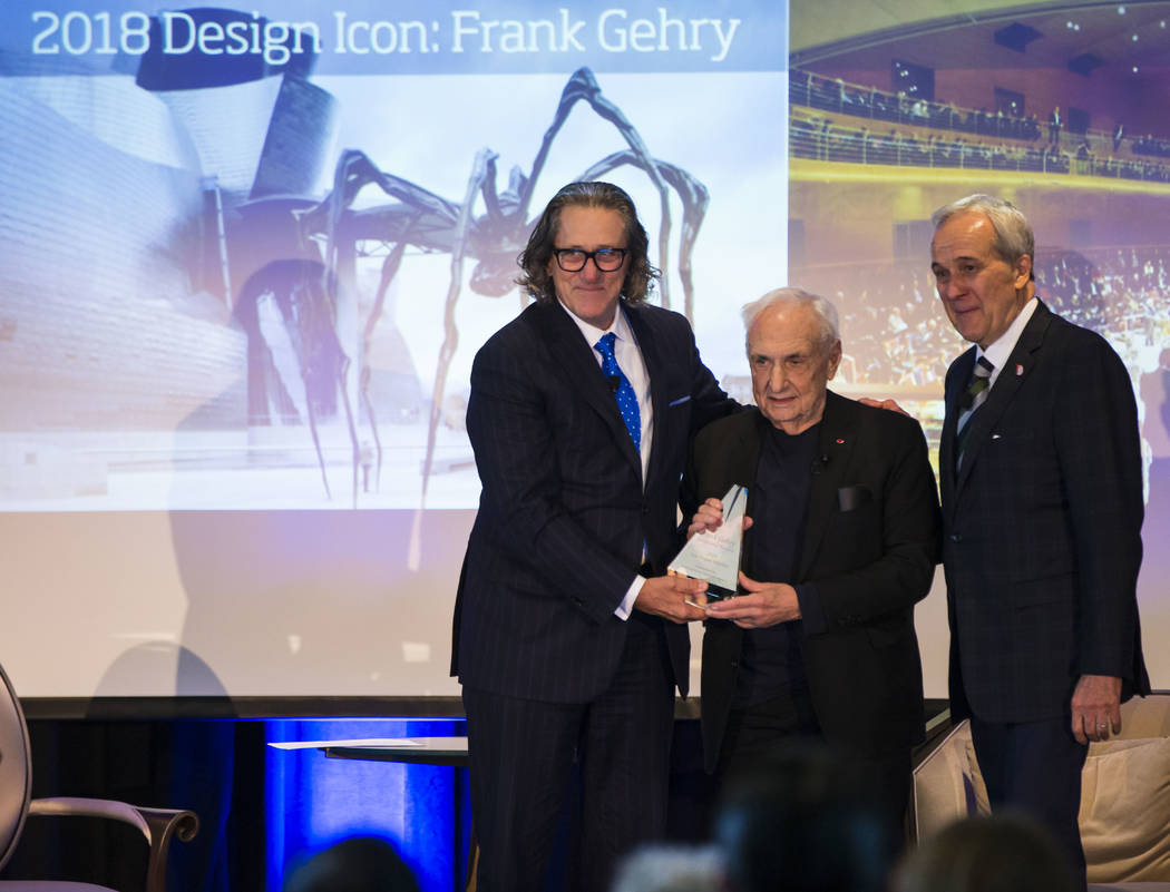 Famed architect Frank Gehry, center, is presented the 2017 Design Icon award by International Market Centers CEO Robert Maricich, left, as philanthropist Larry Ruvo looks on at the conclusion of a ...
