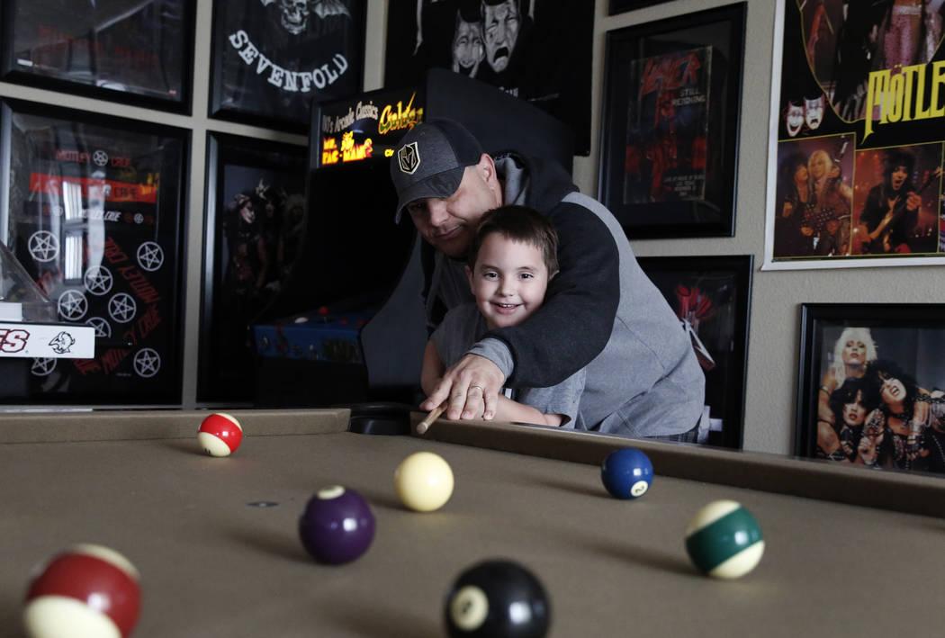 Jason Sebron, 5, and his father Rick Nostro play pool at their Henderson home on Wednesday, April 11, 2018. Bizuayehu Tesfaye/Las Vegas Review-Journal @bizutesfaye