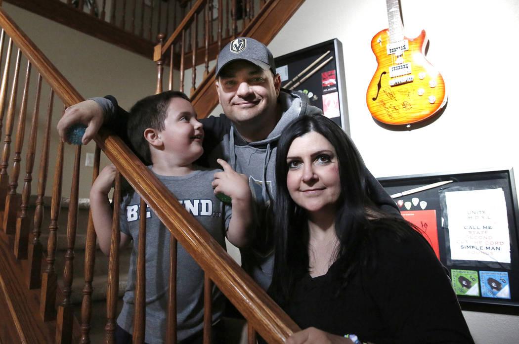 Jason Sebron, 5, poses with his father, Rick Nostro, and mother, Rhonda Sebron, at their Henderson home on Wednesday, April 11, 2018. Bizuayehu Tesfaye/Las Vegas Review-Journal @bizutesfaye